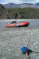 A raft is parked on a gravel bar along the upper Matanuska River about 15 miles upstream from its confluence with the Chickaloon River.