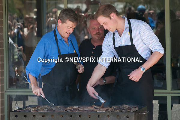 "PRINCE WILLIAM.Prince William visited the Flowerdale Community, where families who lost their homes last year in the bushfires live in temporary housing. Whilst at the Community event the Prince participated in cooking some sausages and burgers on a BBQ with Bill Shorten Mister for infrastructure and reconstruction. The Prince then moved on for some drinks with the families before playing cricket with Bret Lee and Matt Hayden. Before leaving the community William planted a tree. Flowerdale, Shire of Murrindindi_21/01/2010.Mandatory Credit Photo: ©DIAS-NEWSPIX INTERNATIONAL..**ALL FEES PAYABLE TO: ""NEWSPIX INTERNATIONAL""**..IMMEDIATE CONFIRMATION OF USAGE REQUIRED:.Newspix International, 31 Chinnery Hill, Bishop's Stortford, ENGLAND CM23 3PS.Tel:+441279 324672  ; Fax: +441279656877.Mobile:  07775681153.e-mail: info@newspixinternational.co.uk"