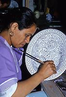 Ceramics, Nabeul, Tunisia.  Woman Painting Design on Ceramic.  Le Caravane Workshop.