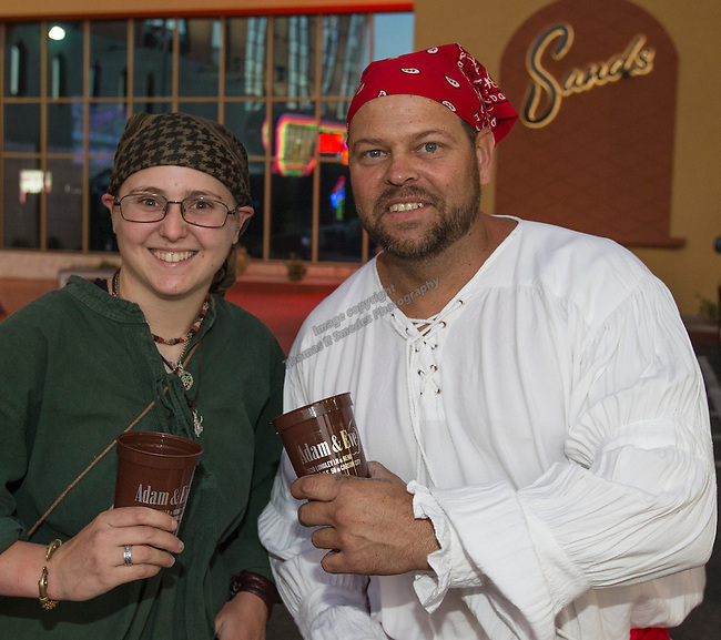Mary McDermott and Anand Vader from Reno during the Pirate Crawl held in downtown Reno on Saturday night, August 13, 2016.