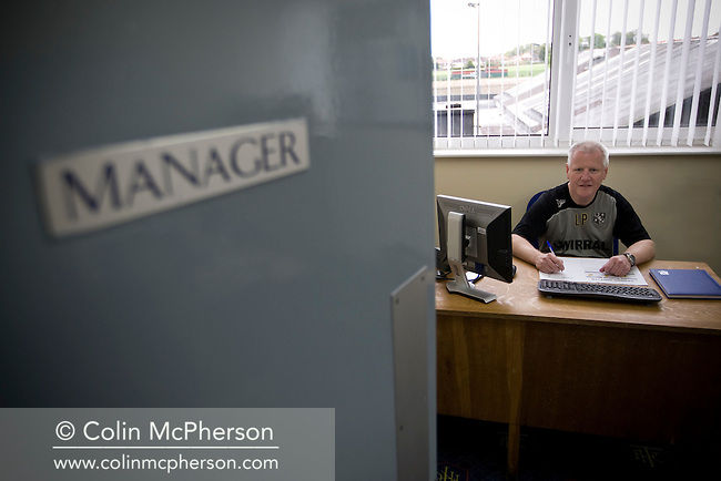Les Parry, manager of Tranmere Rovers, pictured in his office at the club's Prenton Park stadium. Parry was appointed after the sacking of John Barnes in October 2009. Parry was the club's long-serving physio and was tasked with trying to avoid relegation from England's League 1.