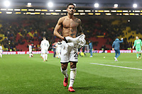 Kyle Naughton of Swansea City gives his shirt to an away supporter during the Premier League match between Watford and Swansea City at the Vicarage Road, Watford, England, UK. Saturday 30 December 2017