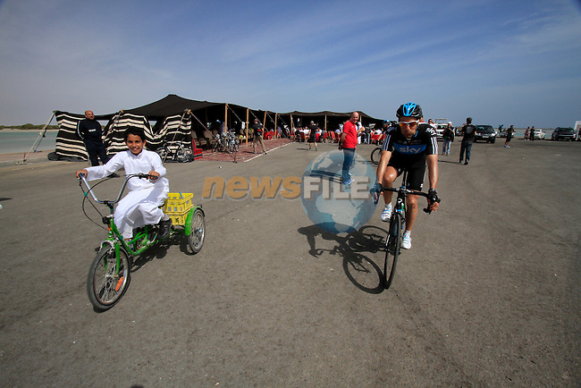 Local boy gives Sky Procycling's Juan Antonio Flecha (ESP) a run for his money before the start of Stage 4 of the 2012 Tour of Qatar from Al Thakhira to Madinat Al Shamal, Al Thakhira port Qatar, 8th February 2012 (Photo Eoin Clarke/Newsfile)