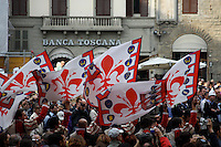 The  Florentine  Flagwavers passing by the crowds of  curios by standing  tourist in center city of Florence. The Flagwavers   are the most important attraction during any major festivals in Florence.