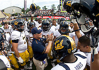 California head coach Jeff Tedford huddles with his players before the game against Washington at Seattle, Washington on September 24th, 2011.  Washington defeated California 31-23.