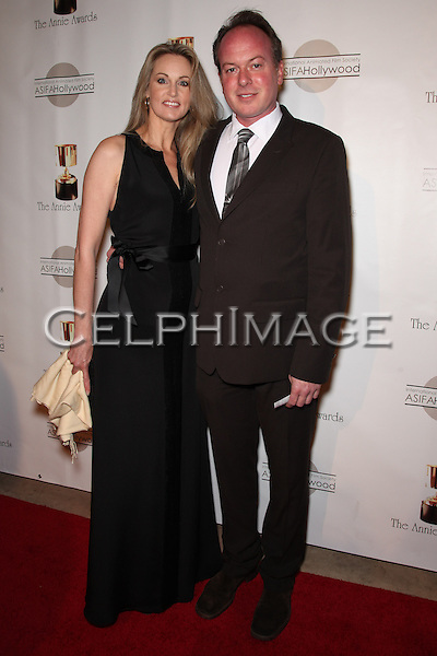BRIEANNE CAMERON, TOM MCGRATH. Red Carpet arrivals to the 37th Annual Annie Awards Gala at Royce Hall on the UCLA campus. Los Angeles, CA, USA. February 6, 2010.