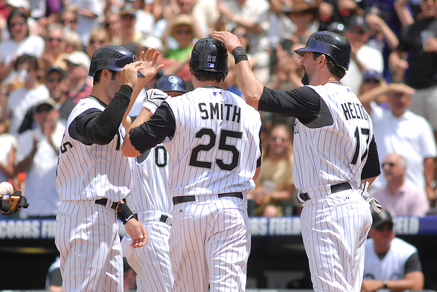 25 May 2008: Colorado Rockies outfielder Seth Smith is congratulated by Ryan Spilborghs (left) and Todd Helton after hitting a 3 run homerun against the New York Mets. Helton and Spilborghs scored on the play. The 3 run homerun was the first homerun of Smith's major league career. The Rockies defeated the Mets 4-1 at Coors Field in Denver, Colorado. FOR EDITORIAL USE ONLY. FOR EDITORIAL USE ONLY