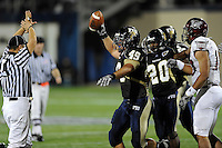 17 October 2009:  FIU linebacker Tyler Clawson (49) celebrates after recovering a fumble in the second quarter of the Troy 42-33 victory over FIU at FIU Stadium in Miami, Florida.