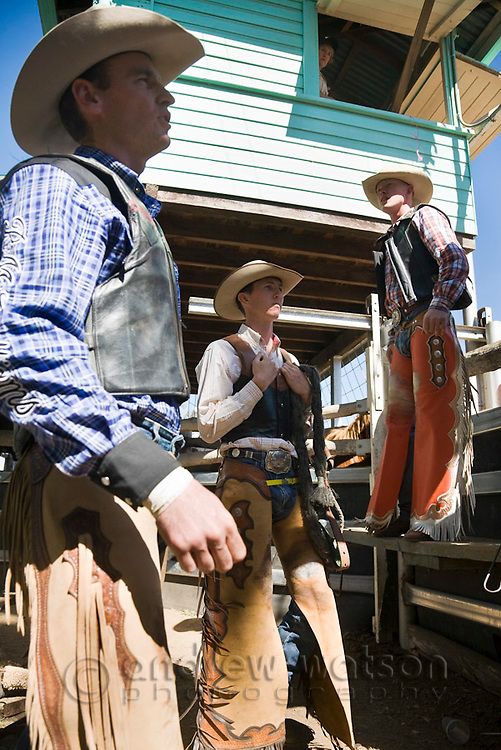Cowboys await the start of saddle bronc riding competition.  Mareeba Rodeo, Mareeba, Queensland, Australia