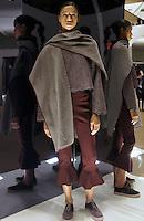 Model In Look 17: Mauve Polar Fleece Poncho, Novelty Sweatshirt, Burgundy Solid Pant