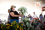 Michelle Corbo picks out some flowers at the Sunday Certified Farmers' Market in Sacramento, California.