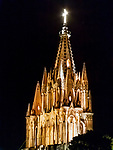 Parroquia de San Miguel Arcangel, at night, viewed from a nearby rooftop restaurant.