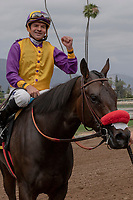 ARCADIA, CA  JUNE 16: Kent Desormeaux gives a fist pump after he and #6 Ollie's Candy win the Summertime Oaks (Grade ll) on June 16, 2018 at Santa Anita Park in Arcadia, CA. (Photo by Casey Phillips/Eclipse Sportswire/Getty Images)