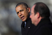 United States President Barack Obama, left, speaks during an arrival ceremony with President Francois Hollande of France on the South Lawn of the White House in Washington, D.C., U.S., on Tuesday, Feb. 11, 2014. <br /> Credit: Andrew Harrer / Pool via CNP