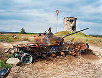 Russian tank on former shooting range of the Soviet army. The terrain is now in use by the German army. The Cold War, which formed part of the collective consciousness of post war Europe from 1945 until 1989, dominated the military and political landscape. These sparse and ageing relics of the covert war in Europe remain as testaments to the existence of this significant period in the shared history of the East and West. CHECK with MRM/FNA