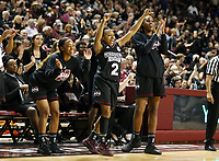 Mississippi State University basketball players celebrate during Thursday's [Jan. 11] win over the University of Mississippi at Humphrey Coliseum. With the 76-45 victory, the Bulldogs now have won eight consecutive games in the rivalry. The undefeated Bulldogs sit atop the Southeastern Conference standings and will return to action Sunday [Jan. 14] with a 3 p.m. home against the University of Alabama. Pictured, from left to right, are freshman Myah Taylor of Olive Branch, senior Morgan William of Birmingham and sophomore Zion Campbell of Washington, D.C. <br />  (photo by Kelly Price / &copy; Mississippi State University Athletics)