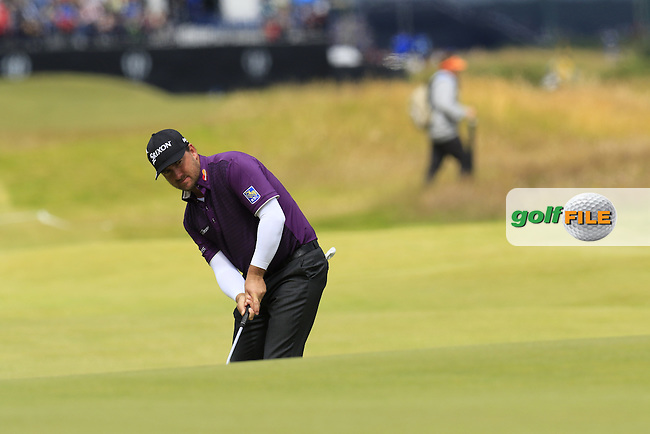 Graeme McDOWELL (NIR) putts onto the 17th green during Sunday's Round  of the 144th Open Championship, St Andrews Old Course, St Andrews, Fife, Scotland. 19/07/2015.<br /> Picture Eoin Clarke, www.golffile.ie