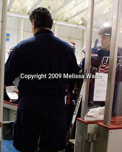 Steve Castelletti (US - Equipment Manager), Zach Budish (US - 24) - Team USA defeated Team Russia 8-1 in their first game during the 2009 USA Hockey National Junior Evaluation Camp on Tuesday, August 11, 2009, in the USA Rink (NHL-sized) at Lake Placid, New York.
