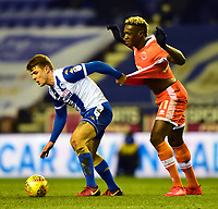 Wigan Athletic's Max Power tangles with Blackpool's Armand Gnanduillet<br /> <br /> Photographer Richard Martin-Roberts/CameraSport<br /> <br /> The EFL Sky Bet League One - Wigan Athletic v Blackpool - Tuesday 13th February 2018 - DW Stadium - Wigan<br /> <br /> World Copyright &copy; 2018 CameraSport. All rights reserved. 43 Linden Ave. Countesthorpe. Leicester. England. LE8 5PG - Tel: +44 (0) 116 277 4147 - admin@camerasport.com - www.camerasport.com