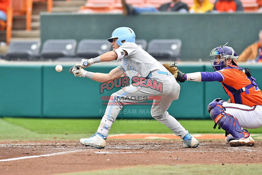 North Carolina Tar Heels left fielder Dylan Enwiller (6) lays down a bunt during a game against the Clemson Tigers at Doug Kingsmore Stadium on March 9, 2019 in Clemson, South Carolina. The Tigers defeated the Tar Heels 3-2 in game one of a double header. (Tony Farlow/Four Seam Images)