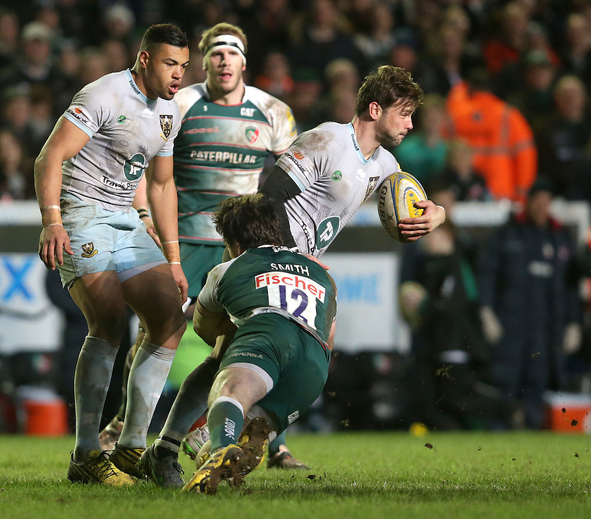 Northampton Saints' Ben Foden is tackled by Leicester Tigers' Matt Smith<br /> <br /> Photographer Rachel Holborn/CameraSport<br /> <br /> Rugby Union - Aviva Premiership Round 9 - Leicester Tigers v Northampton Saints - Saturday 9th January 2016 - Welford Road - Leicester<br /> <br /> &copy; CameraSport - 43 Linden Ave. Countesthorpe. Leicester. England. LE8 5PG - Tel: +44 (0) 116 277 4147 - admin@camerasport.com - www.camerasport.com