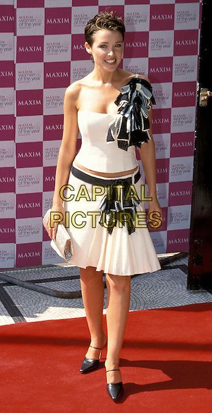DANNI MINOGUE..Maxim Women Of The Year Awards..Ref: 11577..white an black dress, off the shoulder, ruffles..www.capitalpictures.com..sales@capitalpictures.com..©Capital Pictures..full length, full-length