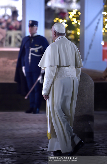 "Pope Francis prays in front of a Nativity scene ""This Nativity was made entirely from the sand of Jesolo beach (Venice), in St Peter's square at the Vatican on December 31, 2018,"