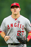 Mike Trout (27) of the Los Angeles Angels jogs in from center field between innings of the Major League Baseball game against the Detroit Tigers at Comerica Park on June 25, 2013 in Detroit, Michigan.  The Angels defeated the Tigers 14-8.  (Brian Westerholt/Four Seam Images)