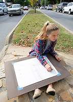 NWA Democrat-Gazette/DAVID GOTTSCHALK  Payton Wiedner, a junior at the University of Arkansas, sketches Monday, September 28, 2015 on the median on Arkansas Avenue in Fayetteville. Wiedner is in the undergraduate art class Studio One and was working on a two point perspective drawing.