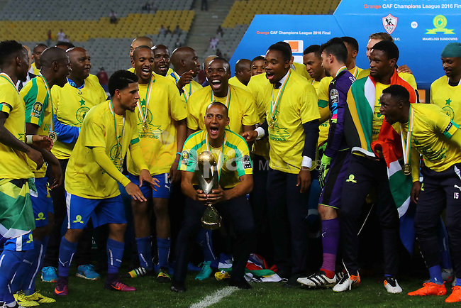 South Africa's Mamelodi Sundowns players celebrate after winning the CAF Champions League football competition following the final match against Egypt's Zamalek club on October 23, 2016 at the Borg el-Arab Stadium near Alexandria. Photo by Stringer