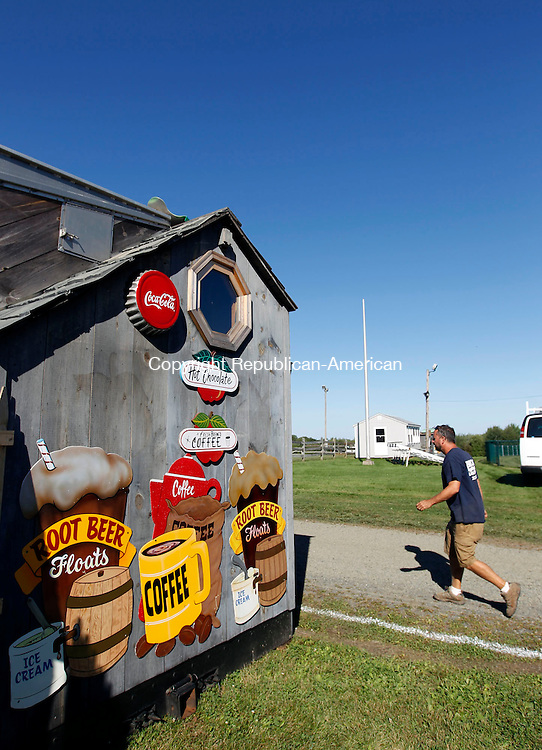Bethlehem, CT- 04 September 2013-090413CM09-  Jim Brooks, owner of Brooks Landscaping of Bethlehem sets up for the Bethlehem Fair Wednesday afternoon.  The fair opens up Friday night from 5p.m. until 11 p.m. Then on Saturday 8a.m. until 11p.m. and Sunday 8a.m. until 5p.m.  For more information log onto the web and go to http://www.bethlehemfair.com.   Christopher Massa Republican-American