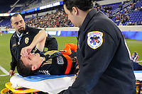 Sebastien Le Toux (9) of the Philadelphia Union is carted off the field after being injured during the second half. The New York Red Bulls defeated the Philadelphia Union 2-1 during a US Open Cup qualifier at Red Bull Arena in Harrison, NJ, on April 27, 2010.