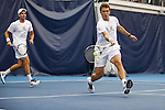24 MAY 2016: Virgina's Luca Corinteli returns volley during doubles play. The Division I Men's Tennis Championship is held at the Michael D. Case Tennis Center on the University of Tulsa campus in Tulsa, OK.  Virginia defeated Oklahoma for the national championship. Shane Bevel/NCAA Photos