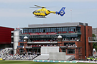 The air ambulance takes off in front of the pavilion after attending a medical emergency during Lancashire CCC vs Essex CCC, Specsavers County Championship Division 1 Cricket at Emirates Old Trafford on 11th June 2018