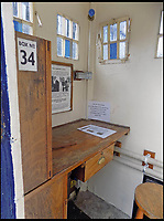 BNPS.co.uk (01202 558833)<br /> Pic: AmberleyPublishing/BNPS<br /> <br /> The interior of a police box, showing the desk and stool used by the police officer.<br /> <br /> The iconic British phonebox has been given a ringing endorsement in a new book charting the expiring institution's fascinating history. <br /> <br /> Aptly titled 'The British Phonebox', the book primarily focuses on the ubiquitous design that's as emblematic to Britain as the black cab, double decker bus and Houses of Parliament. <br /> <br /> Equally interesting are the early chapters, which detail the phonebox's humble 19th century beginnings and the final ones, that bemoan their dwindling numbers <br /> <br /> The 96 page paperback, jointly authored by friends Nigel Linge and Andy Sutton, is published by Amberley and costs &pound;13.49.