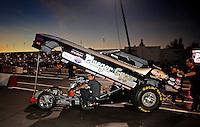 Nov 14, 2010; Pomona, CA, USA; NHRA nostalgia funny car driver Leah Pruett-Leduc and husband Todd Leduc during the Auto Club Finals at Auto Club Raceway at Pomona. Mandatory Credit: Mark J. Rebilas-
