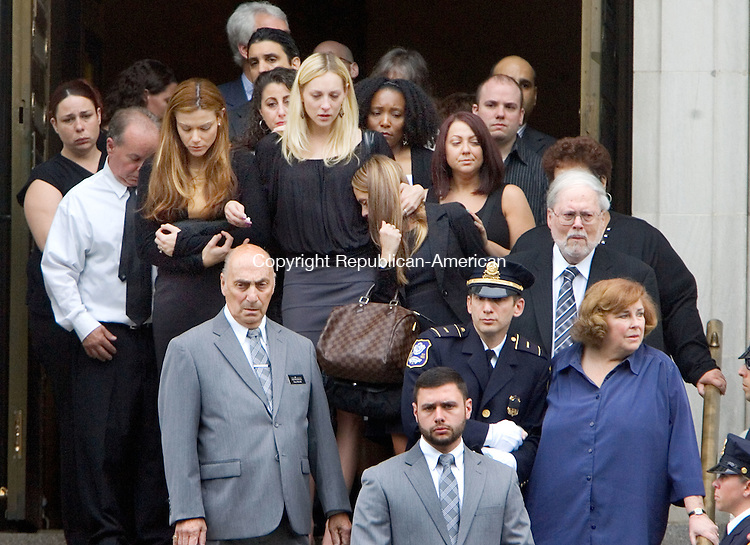 WATERBURY CT. 16 June 2015-061615SV03-Family and friends exit the Basilica of the Immaculate Conception during Acting Deputy Police Chief Christopher Corbett&rsquo;s funeral in Waterbury Tuesday. <br /> Steven Valenti Republican-American