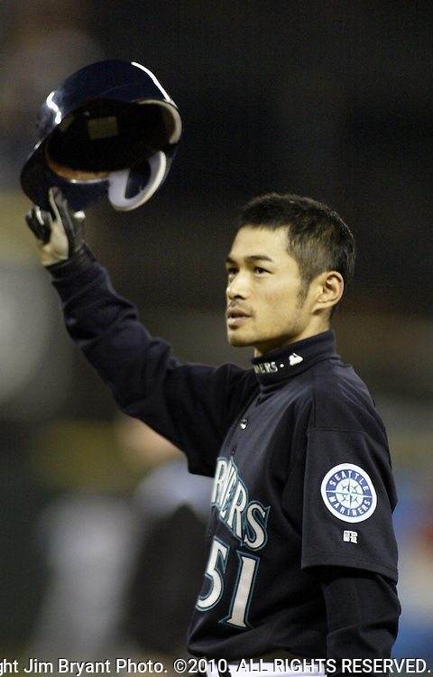 Seattle Mariners Ichiro Suzuki tips his hat to the fans after hitting a ball into left field which tied George Sisler's 1920 single season record of 257 first in the inning at Safeco Field on Friday, Oct. 1, 2004 in Seattle. Jim Bryant Photo. ©2010. ALL RIGHTS RESERVED.