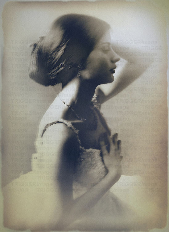 A sepia-toned portrait of a woman's profile, seated, with her left hand touching her hair.