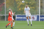 05 November 2008: North Carolina's Rachel Wood (24) heads the ball. The University of North Carolina defeated the University of Miami 1-0 at Koka Booth Stadium at WakeMed Soccer Park in Cary, NC in a women's ACC tournament quarterfinal game.