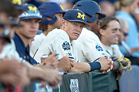 Michigan Wolverines first baseman Jimmy Kerr (15) in the dugout before taking on the Vanderbilt Commodores in Game 1 of the NCAA College World Series Finals on June 24, 2019 at TD Ameritrade Park in Omaha, Nebraska. Michigan defeated Vanderbilt 7-4. (Andrew Woolley/Four Seam Images)