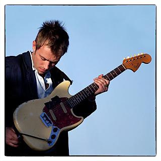 Blur band's Damon Albarn plugs in for their Sundowner set on Saturday, April 26, 2003