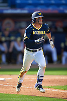 Michigan Wolverines shortstop Michael Brdar (9) runs to first base during the second game of a doubleheader against the Canisius College Golden Griffins on February 20, 2016 at Tradition Field in St. Lucie, Florida.  Michigan defeated Canisius 3-0.  (Mike Janes/Four Seam Images)