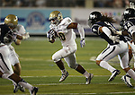 UC Davis' Manusamoa Luuga runs against Nevada in the second half of a college football game in Reno, Nev., on Saturday, Sept. 7, 2013. (AP Photo/Cathleen Allison)