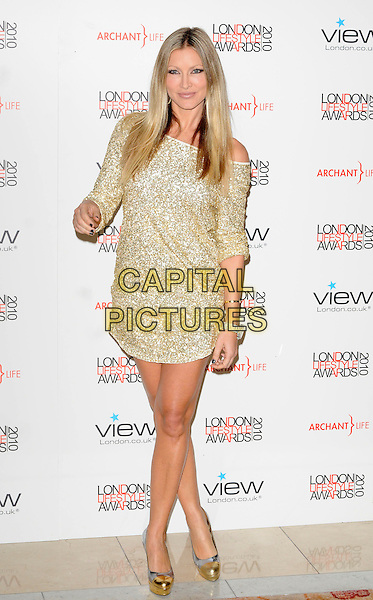 CAPRICE BOURRET.The London Lifestyle Awards, Park Plaza Riverbank Hotel, London, England..October 7th, 2010.full length gold dress off the shoulder platform shoes metallic hand sequins sequined .CAP/CAN.©Can Nguyen/Capital Pictures.