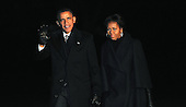 United States President Barack Obama and first lady Michelle Obama return to the White House from foreign travel to Johannesburg, South Africa, Wednesday, December 11, 2013 in Washington, DC. The President and the First Lady attended the national memorial service for former South African President Nelson Mandela.<br /> Credit: Olivier Douliery / Pool via CNP
