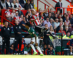 Leon Clarke of Sheffield Utd tussles with Rico Henry of Brentford during the English Championship League match at Bramall Lane Stadium, Sheffield. Picture date: August 5th 2017. Pic credit should read: Simon Bellis/Sportimage