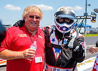 Jun 8, 2019; Topeka, KS, USA; NHRA top fuel driver Scott Palmer (right) with sponsor Tommy Thompson during qualifying for the Heartland Nationals at Heartland Motorsports Park. Mandatory Credit: Mark J. Rebilas-USA TODAY Sports