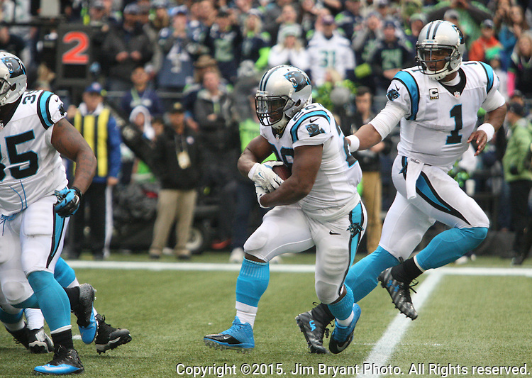 Carolina Panthers Quarterback Kam Newton (1) hands the ball off to running back Jonathan Stewart (28) at CenturyLink Field in Seattle on October 18, 2015. The Panthers came from behind with 32 seconds remaining in the 4th Quarter to beat the Seahawks 27-23.  ©2015 Jim Bryant Photography. All Rights Reserved.