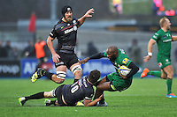 Topsy Ojo of London Irish is tackled to ground. Aviva Premiership match, between Saracens and London Irish on January 3, 2015 at Allianz Park in London, England. Photo by: Patrick Khachfe / JMP